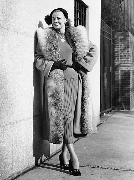 Woman wearing fur coat posing outdoors, (B&W), (Portrait) stock photo