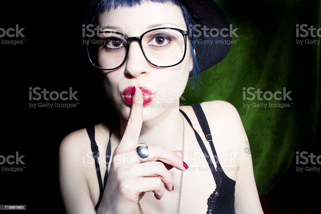 woman wearing glasses and be quiet royalty-free stock photo