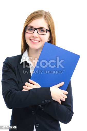 istock Woman wearing glasses in business suit holding blue folder 467409409