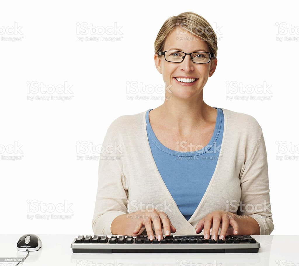 Woman Wearing Glasses Typing On Keyboard royalty-free stock photo