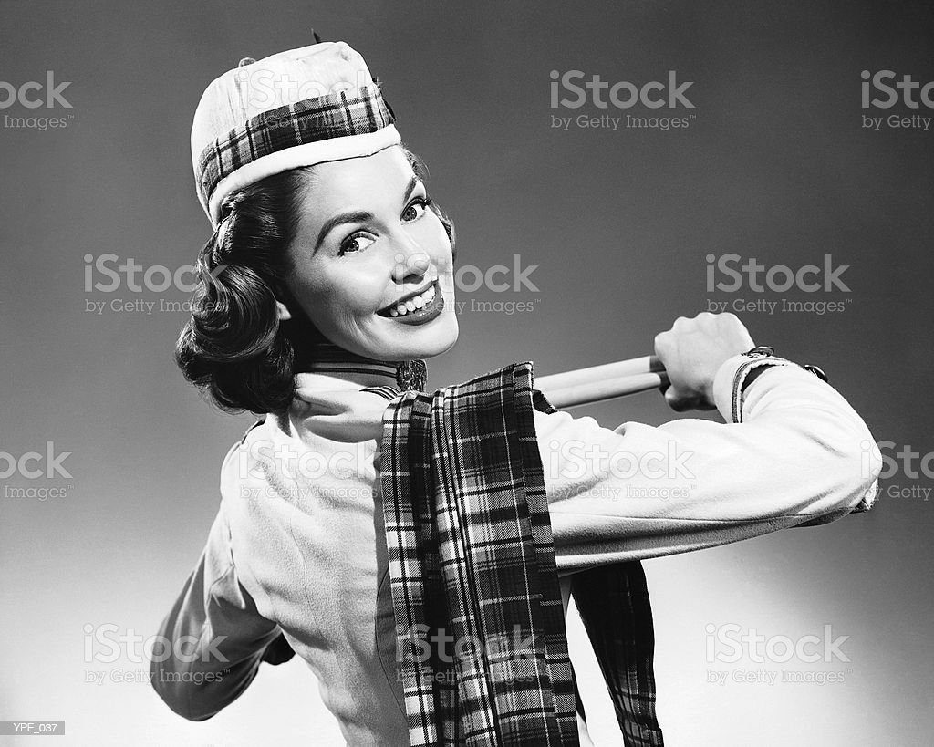 Woman wearing glengarry cap and tartan royalty free stockfoto
