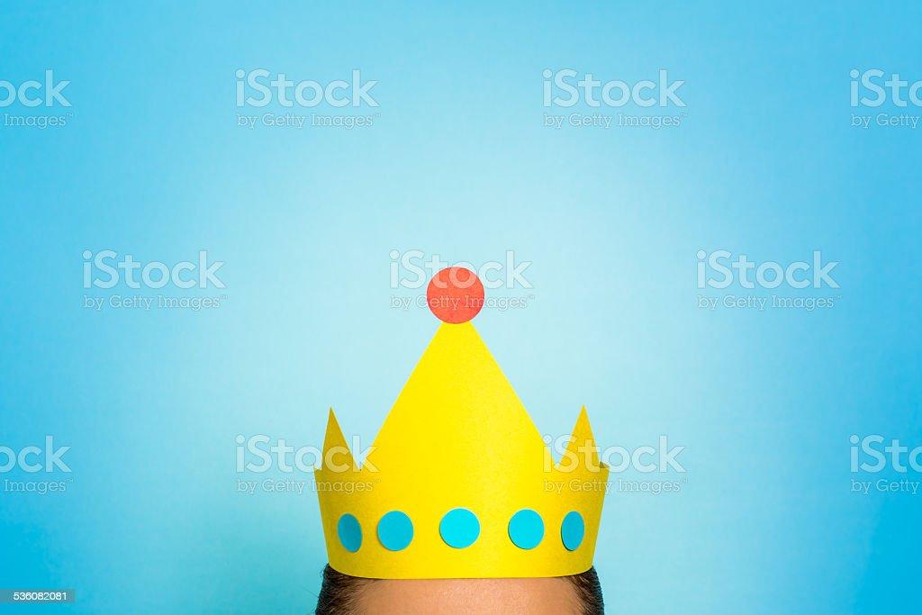 Woman wearing golden yellow crown. Loyalty marketing, Storytelling. stock photo