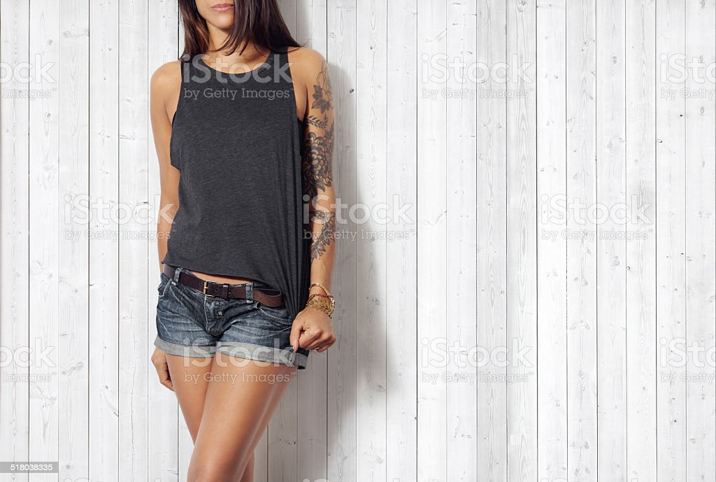 Woman wearing grey vest stock photo