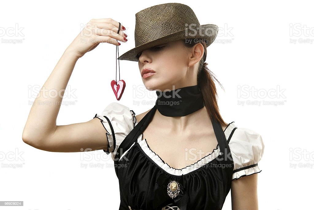 Woman wearing hat showing heart shaped pendent royalty-free stock photo