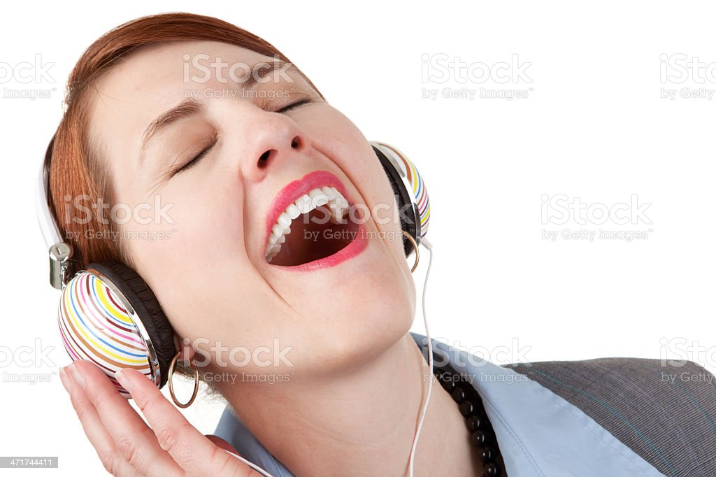 Woman Wearing Headphones and Singing royalty-free stock photo
