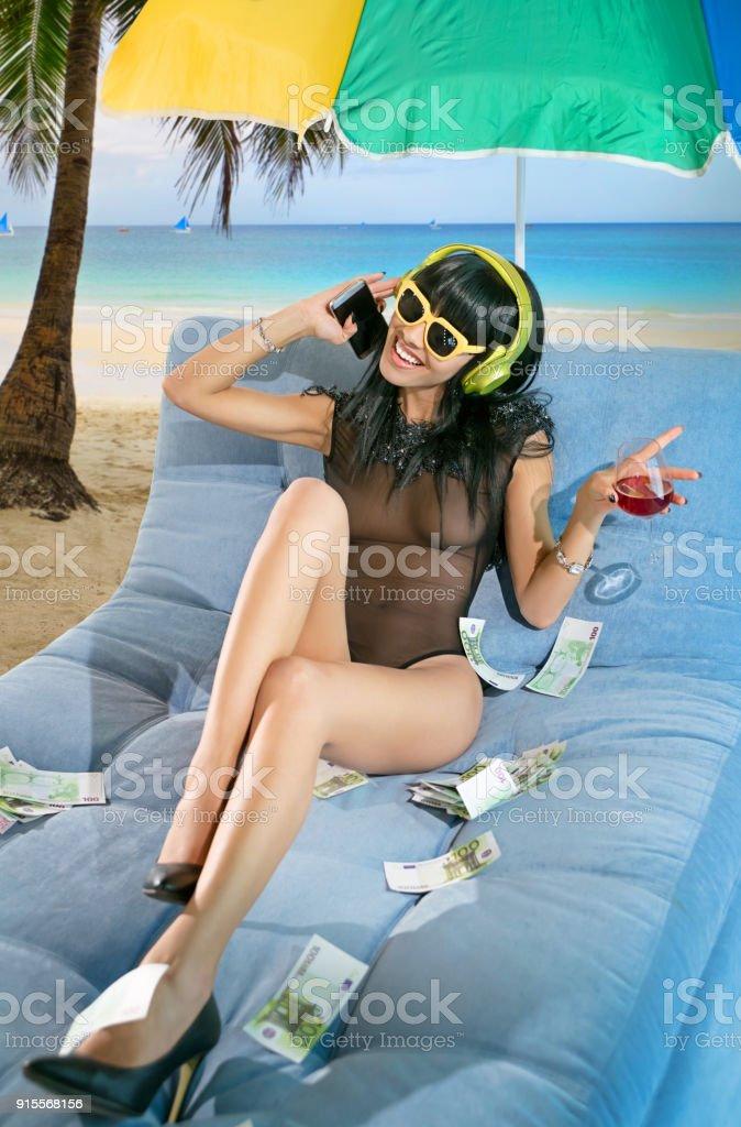 Woman wearing headphones on the beach stock photo