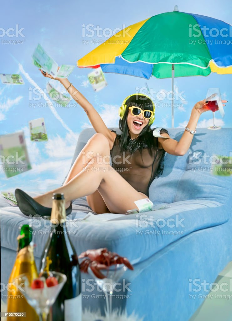 Woman wearing headphones on the beach stock photo
