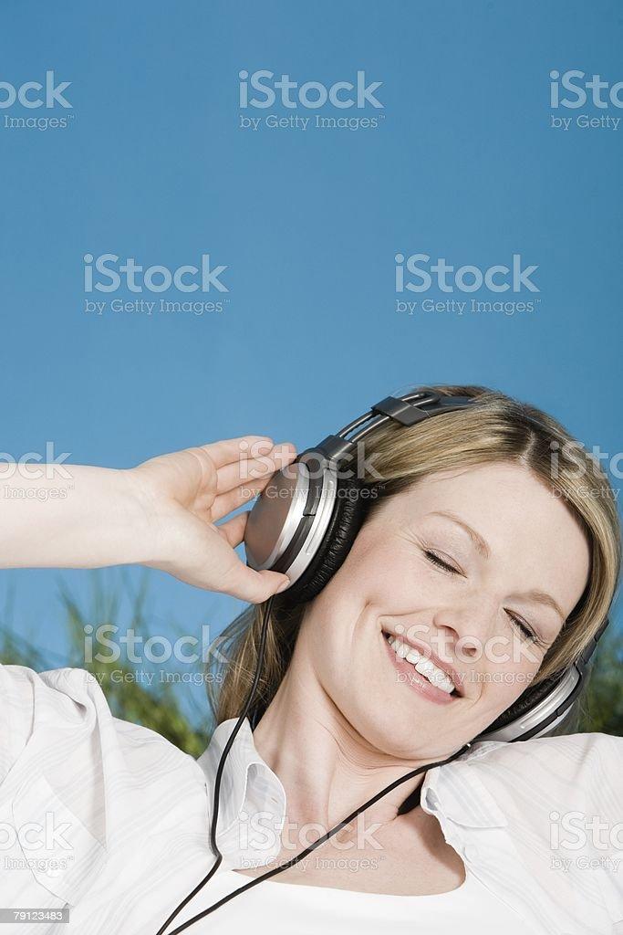 Woman wearing headphones 免版稅 stock photo