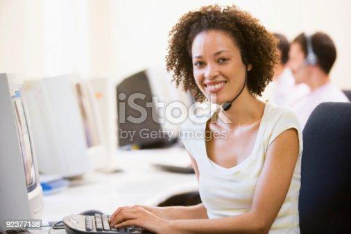 istock Woman wearing headset in computer room 92377138