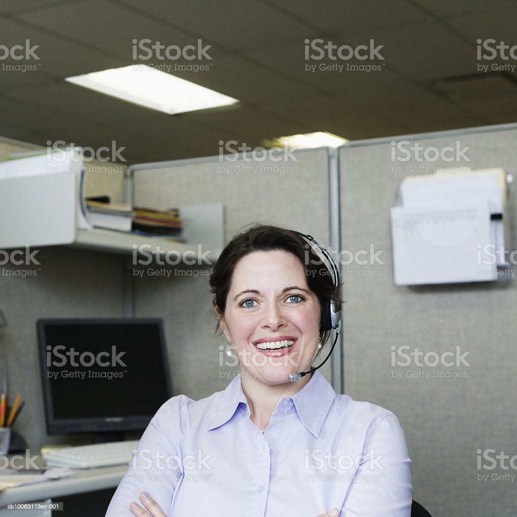 Woman wearing headset, smiling, portrait royalty-free stock photo