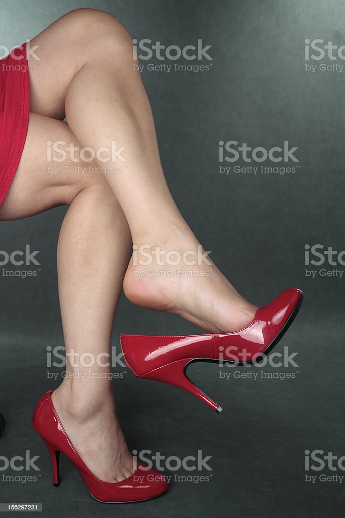 woman  wearing   heels over grey royalty-free stock photo