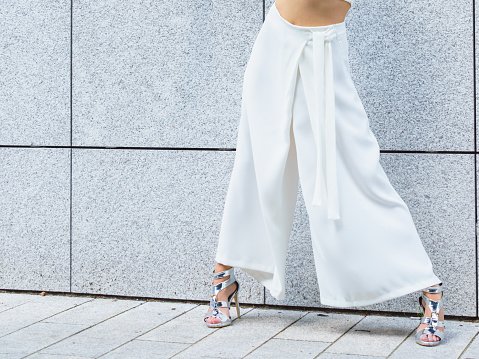 istock Woman wearing high heels and culottes 1092153956