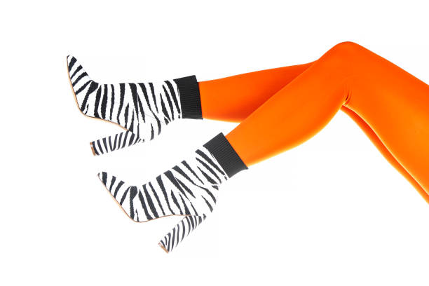 Woman wearing high heels ankle boots in zebra pattern stock photo