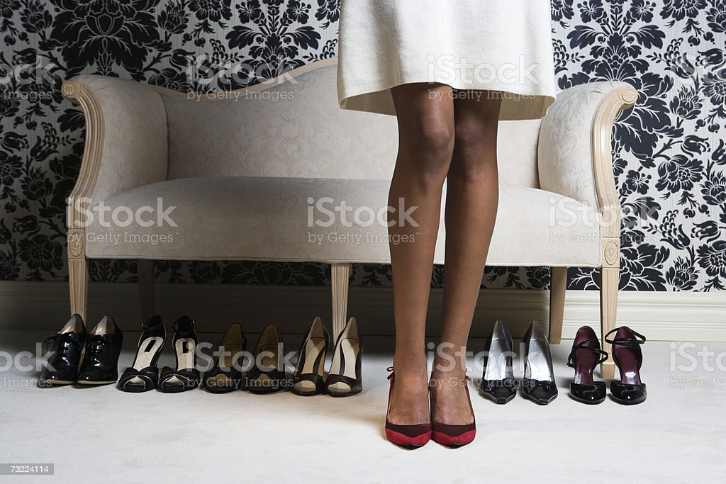 Woman wearing high heels shoes, low section stock photo