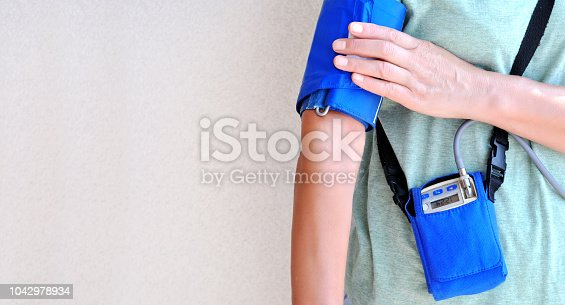 istock Woman wearing holter monitor device for daily monitoring of an electrocardiogram. Health care and disease prevention. Space for test 1042978934