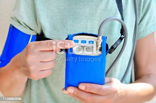 istock Woman wearing holter monitor device for daily monitoring of an electrocardiogram. Health care and disease prevention. 1129683698