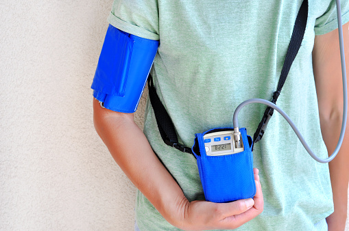 istock Woman wearing holter monitor device for daily monitoring of an electrocardiogram. Health care and disease prevention. 1129683706