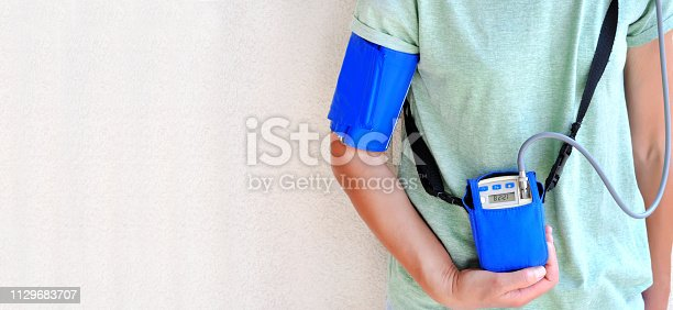 istock Woman wearing holter monitor device for daily monitoring of an electrocardiogram. Health care and disease prevention. 1129683707