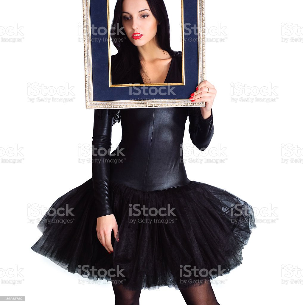 Woman wearing in black dress holding picture frame. Isolate stock photo