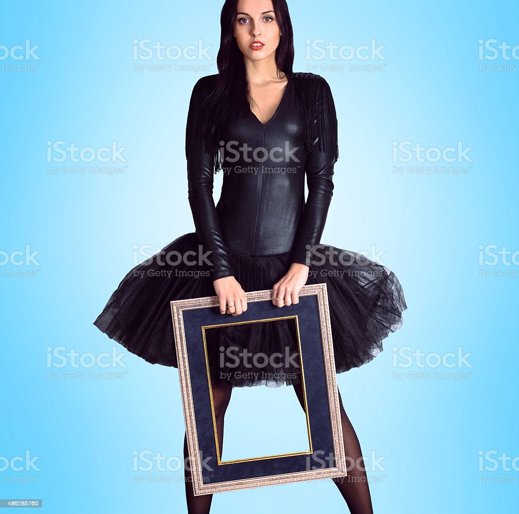 Woman wearing in black dress holding picture frame stock photo