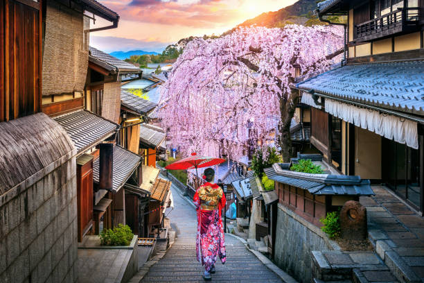 Woman wearing japanese traditional kimono walking at Historic Higashiyama district in spring, Kyoto in Japan. stock photo