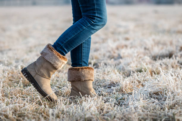 Woman wearing leather boots with fur at winter stock photo