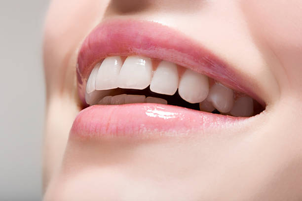 Woman wearing lip gloss  teeth stock pictures, royalty-free photos & images