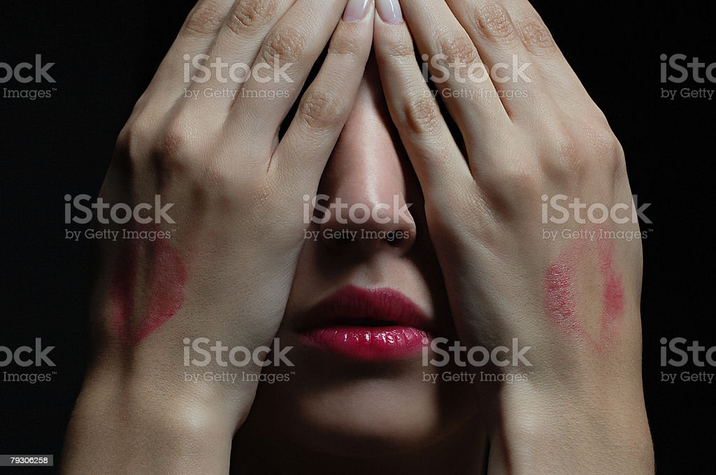 Woman wearing lipstick and covering her face royalty-free 스톡 사진
