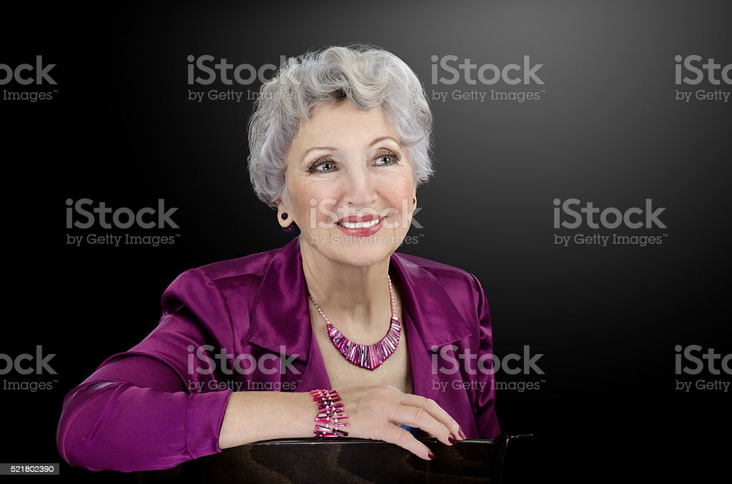 Woman wearing magenta mother of pearl shell stick beads stock photo