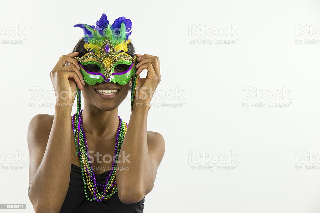 Woman wearing Mardi Gras mask with big smile stock photo