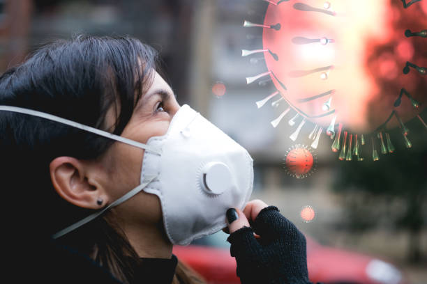 woman wearing mask as a protection from viruses stock photo