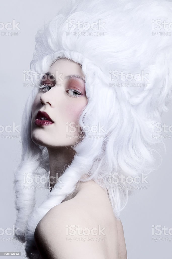 Woman Wearing Medieval Style White Wig stock photo