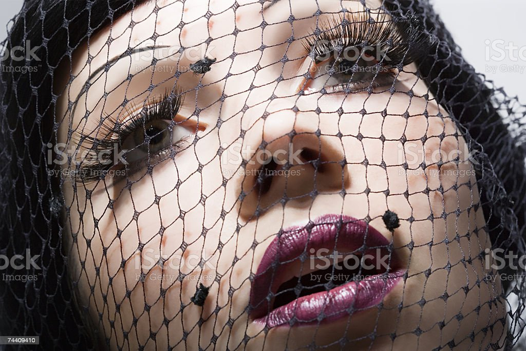 Woman wearing net over face royalty-free stock photo