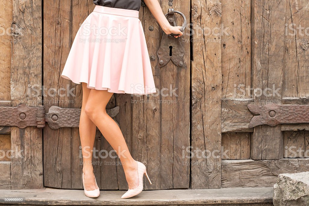 Woman wearing nude colored high heel shoes stock photo