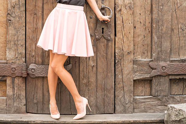 Woman wearing nude colored high heel shoes Woman wearing nude colored high heel shoes; fashion shoot in old city nude women pics stock pictures, royalty-free photos & images