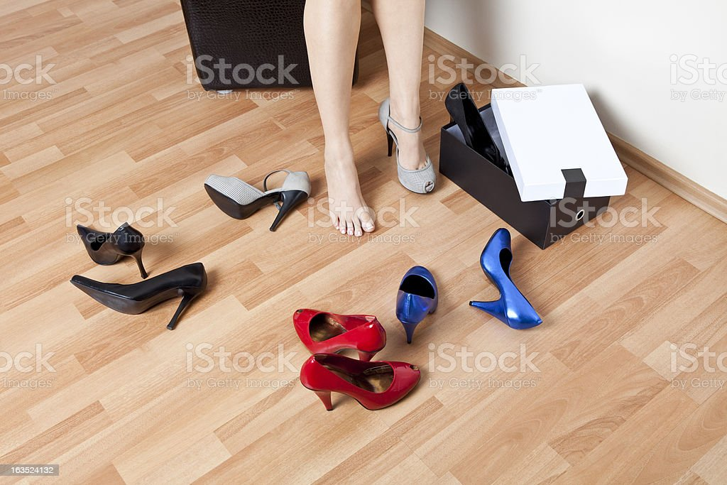 Woman wearing on high heel shoes royalty-free stock photo