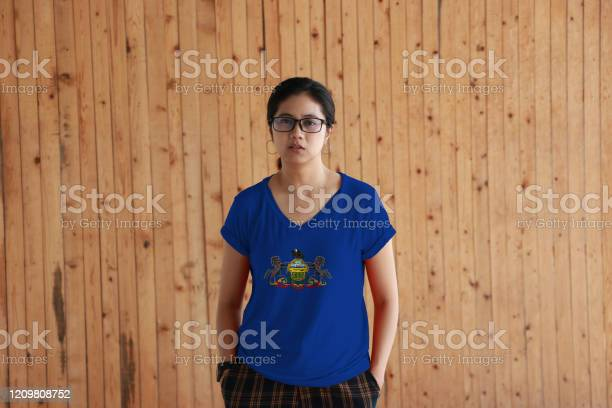 Woman wearing pennsylvania flag color shirt and standing with two in picture id1209808752?b=1&k=6&m=1209808752&s=612x612&h=vmslfjh1soey7rzv orsss8dsgm05n4gkvh shskepg=