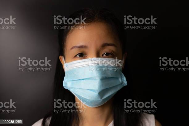 Woman wearing protection face mask against coronavirus or covid19 in picture id1220381255?b=1&k=6&m=1220381255&s=612x612&h=h7iwehr94sukyvbvvwodtze r8ffwfcvswzgvllc4ls=