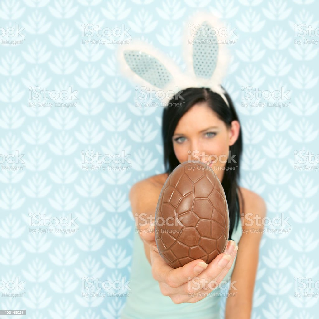 Woman Wearing Rabbit Ears and Holding Easter Eggs stock photo