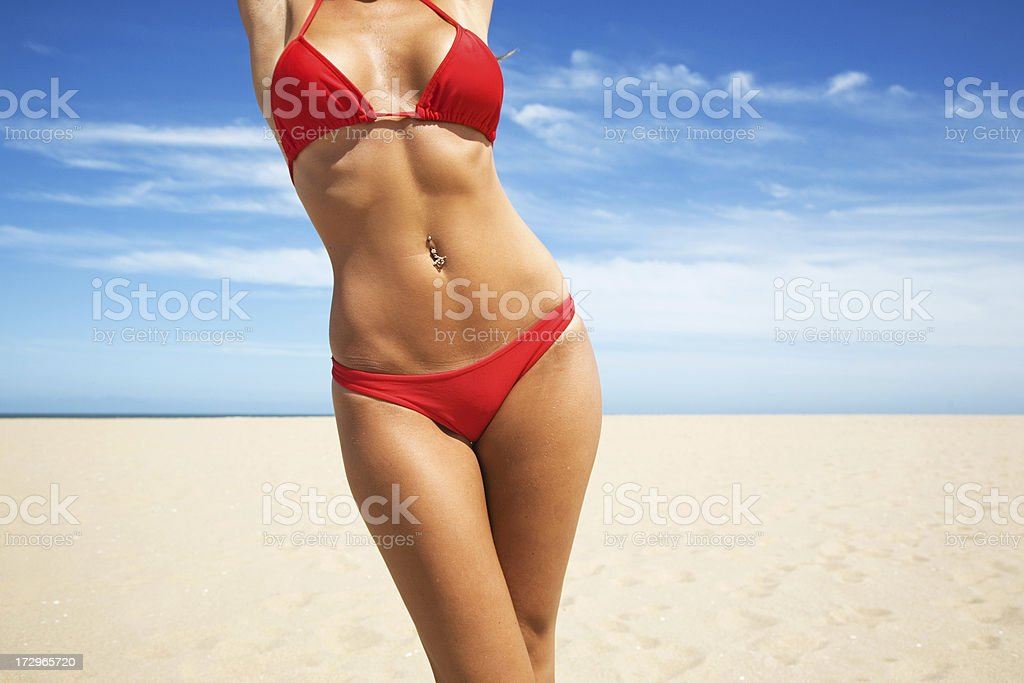 Woman wearing red bikini with beach background stock photo