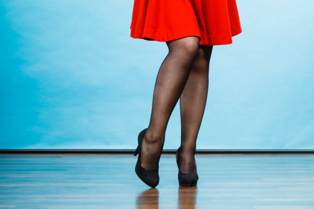 woman wearing red dress and high heels - black women wearing pantyhose stock photos and pictures