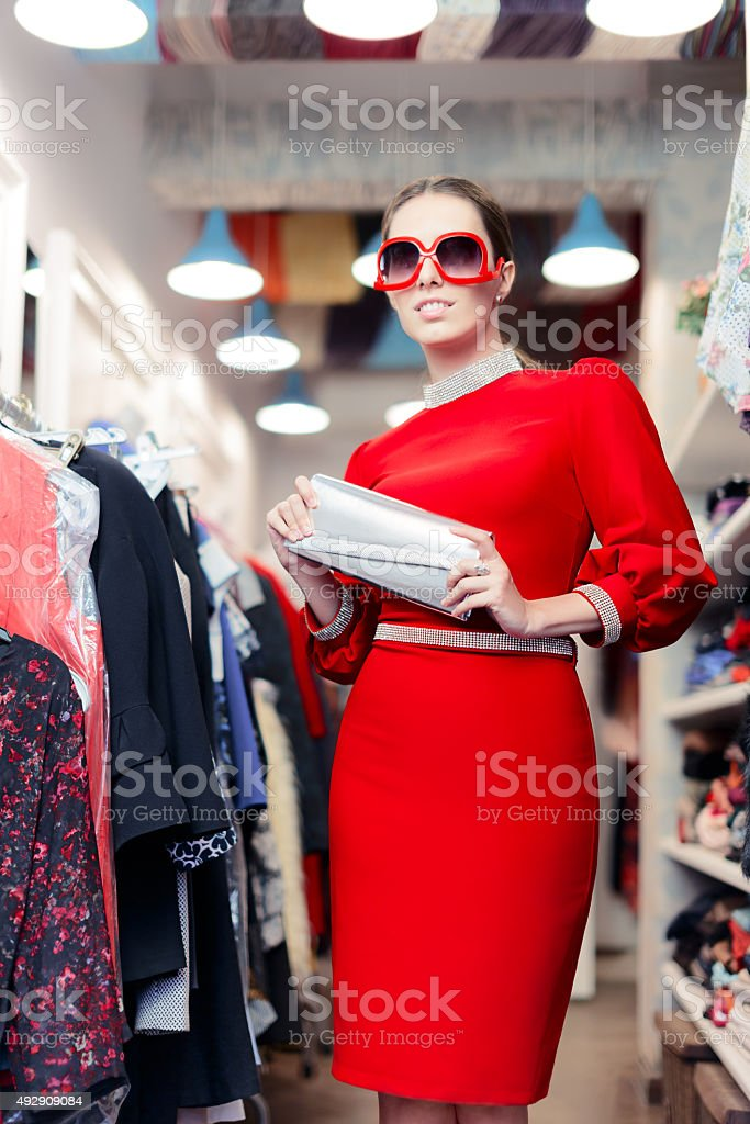 Woman wearing red dress in fashion store stock photo