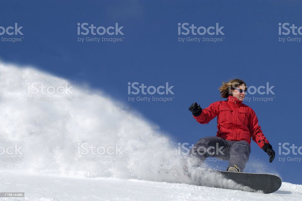Woman wearing red jacket while snowboarding royalty-free stock photo
