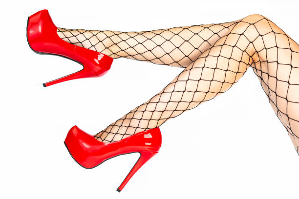 Woman wearing red platform high heels and fishnet stockings stock photo