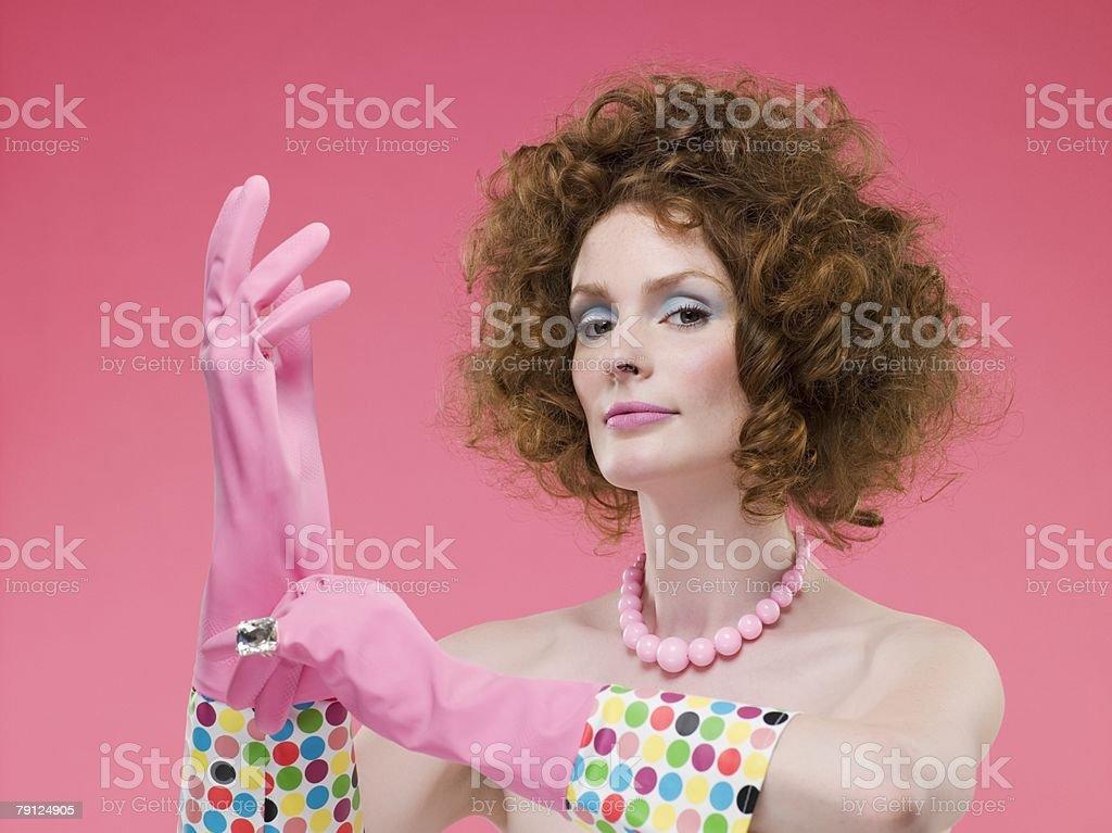 Woman wearing rubber gloves 免版稅 stock photo