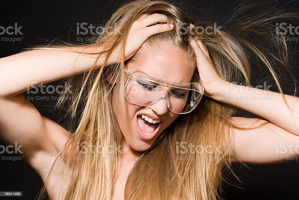A woman wearing safety goggles royalty-free stock photo