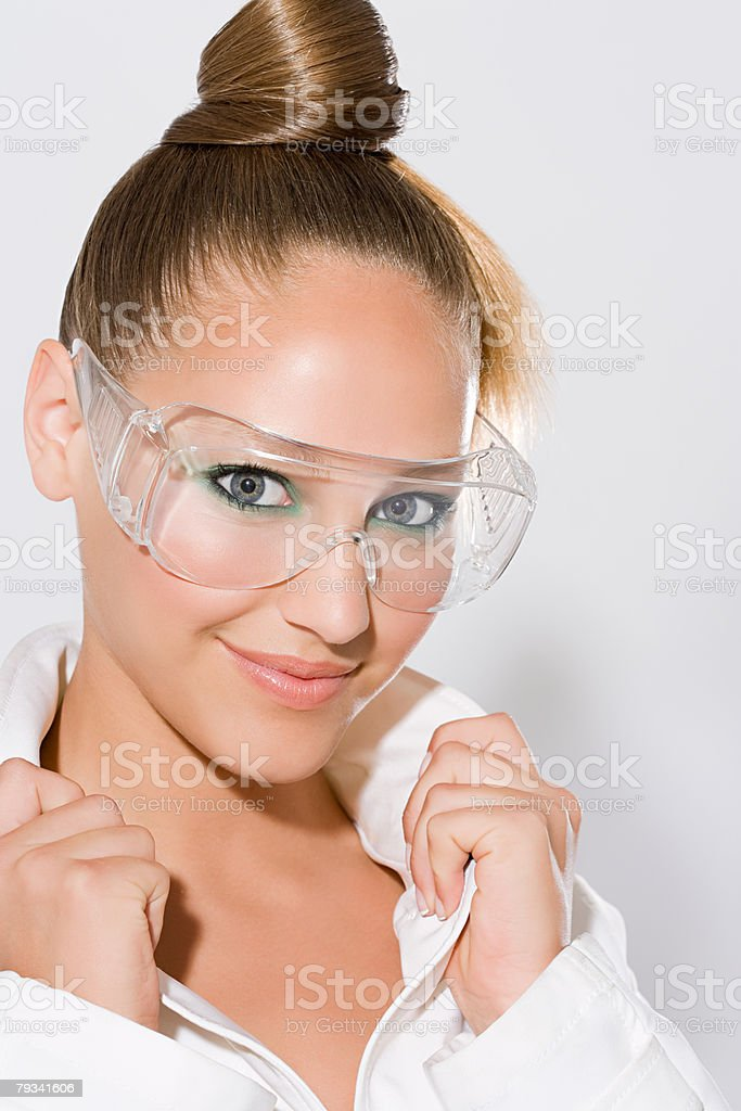 A woman wearing safety goggles royalty-free 스톡 사진