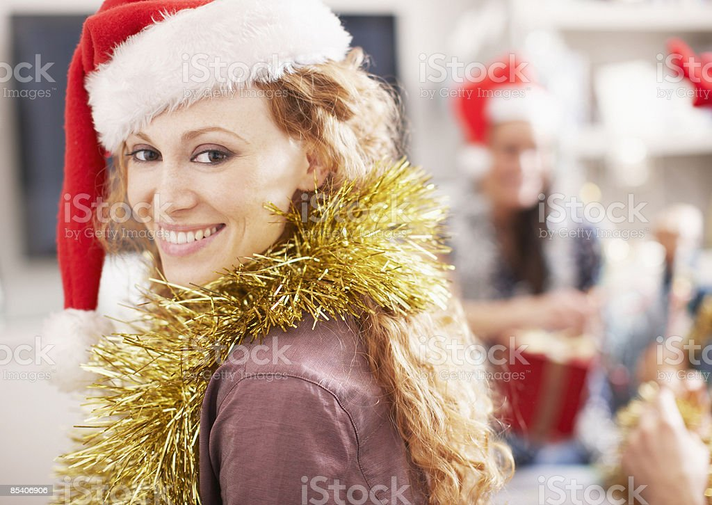 Woman wearing Santa hat royalty-free stock photo