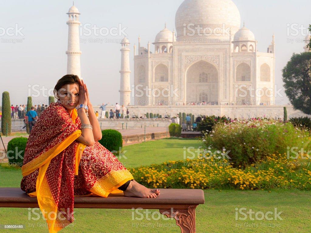 Woman wearing sari at Taj Mahal stock photo