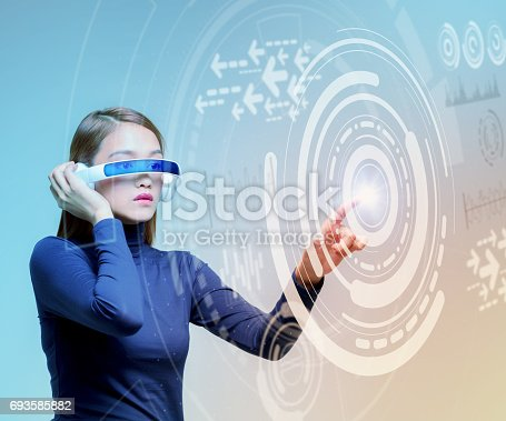 693586040istockphoto woman wearing smart glasses and futuristic graphical user interface 693585882